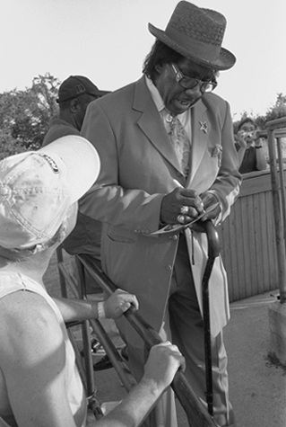Bluesman Signing Autographs, Sunflower River Blues Festival, Clarksdale, Mississippi, 2005